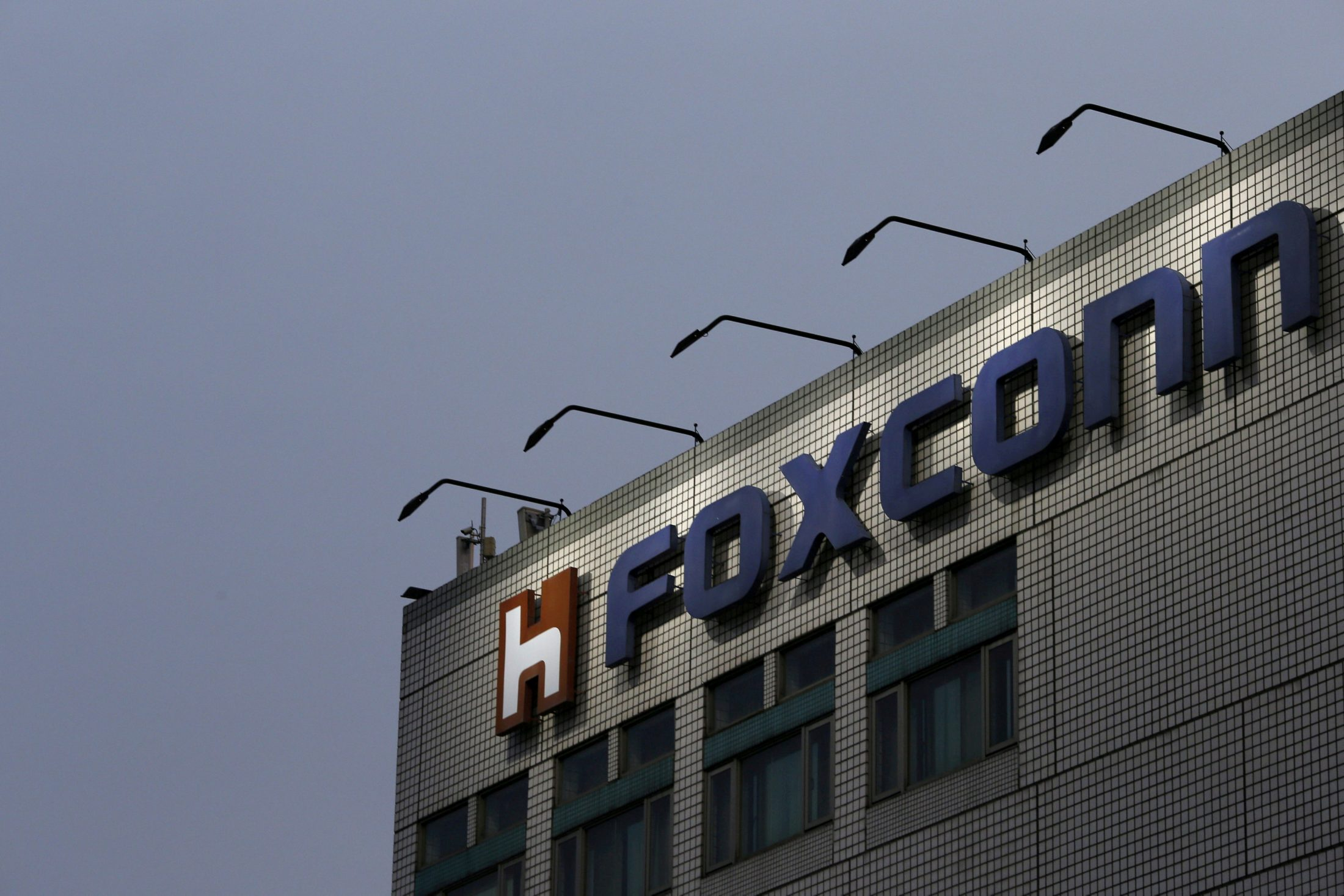 The logo of Foxconn, the trading name of Hon Hai Precision Industry, is seen on top of the company's headquarters in New Taipei City, Taiwan. Photo by Tyrone Siu/Reuters
