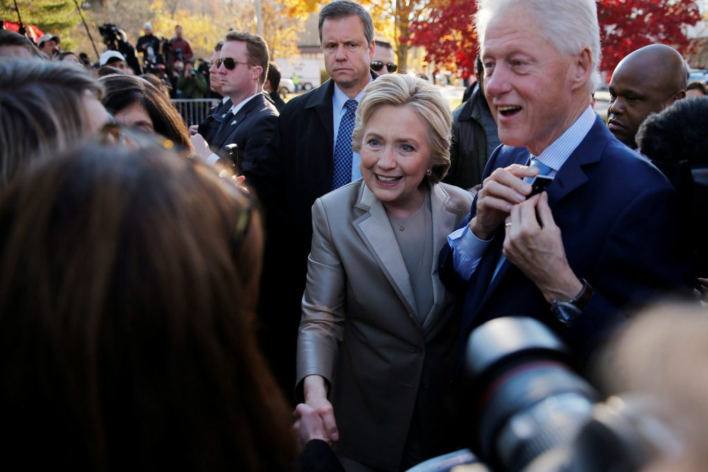Democratic presidential nominee Hillary Clinton and her husband, former President Bill Clinton, greet supporters after casting their ballots at the Douglas Grafflin Elementary School in Chappaqua, New York on Nov. 8. Photo by Brian Snyder/Reuters