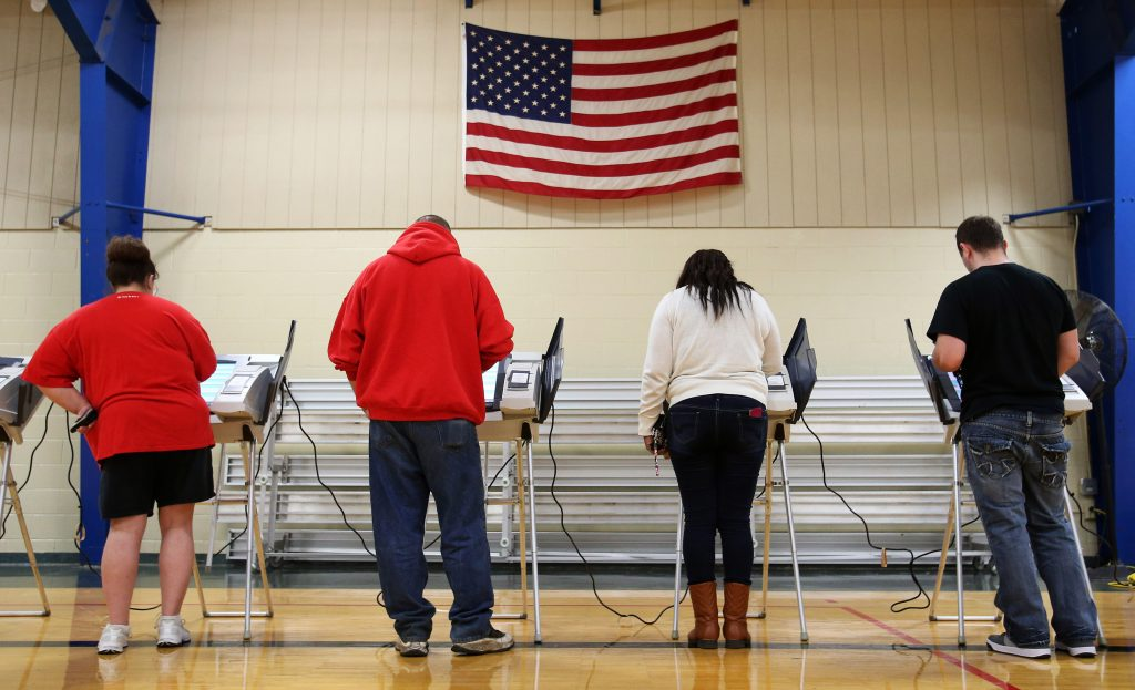 Voters cast their votes during the U.S. presidential election in Elyria, Ohio, on November 8, 2016. Photo by Aaron Josefcz...