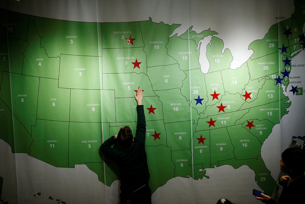 A man marks a star on the Electoral College Map during a U.S. Election Watch event hosted by the U.S. Embassy at a hotel in Seoul, South Korea, November 9, 2016. Photo by Kim Hong-Ji/REUTERS