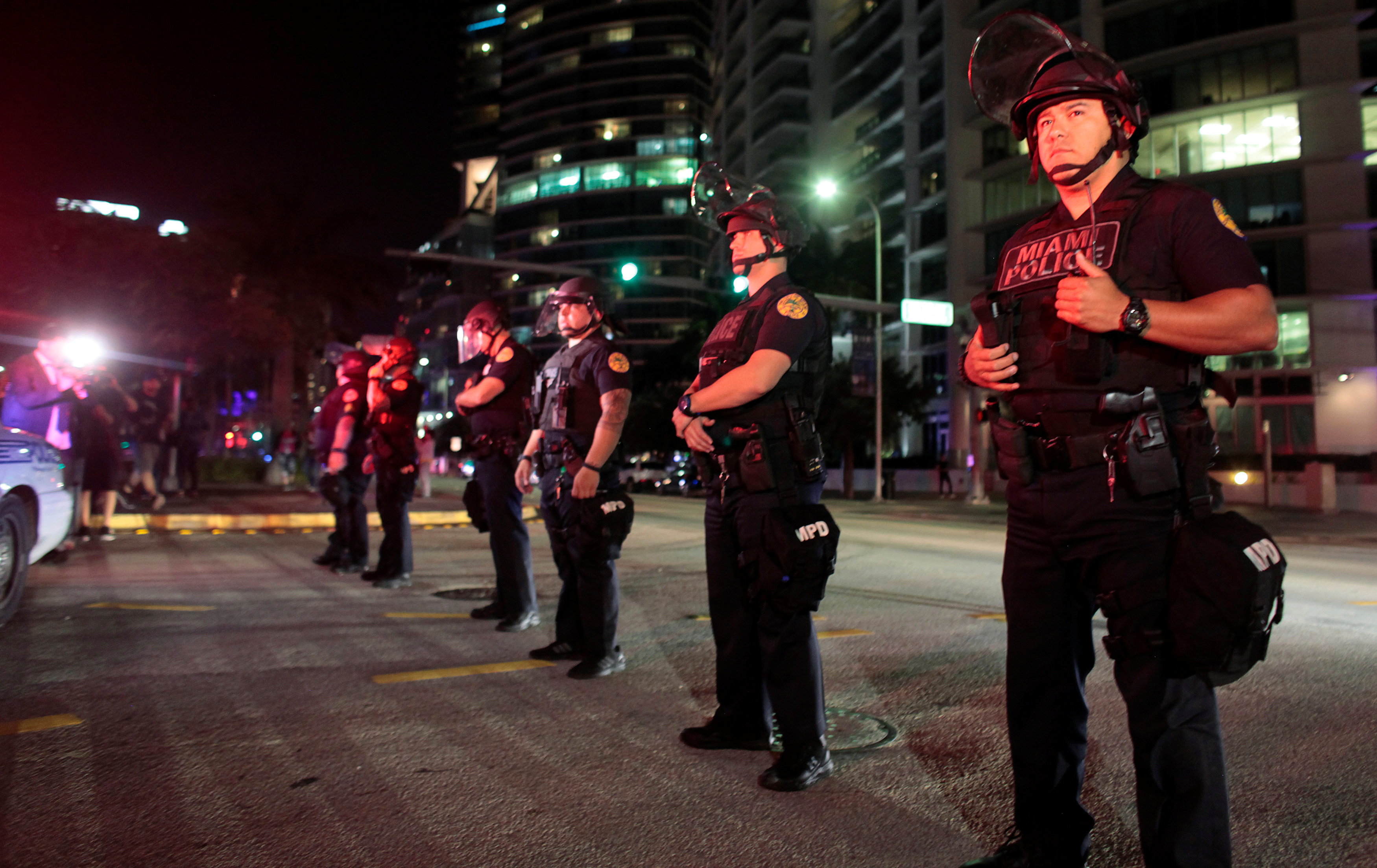 Police officers stand guard during a protest against U.S. President-elect Donald Trump in Miami, Florida, U.S. November 11, 2016. REUTERS/Javier Galeano - RTX2TAO6