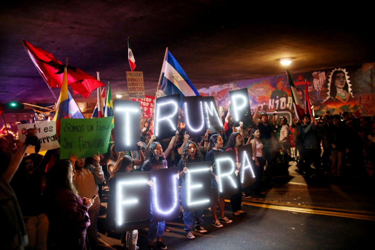 Demonstrators stage a rally against President-elect Donald Trump in the Barrio Logan area of in San Diego, California, U.S. November 11, 2016. REUTERS/Sandy Huffaker - RTX2TAYF