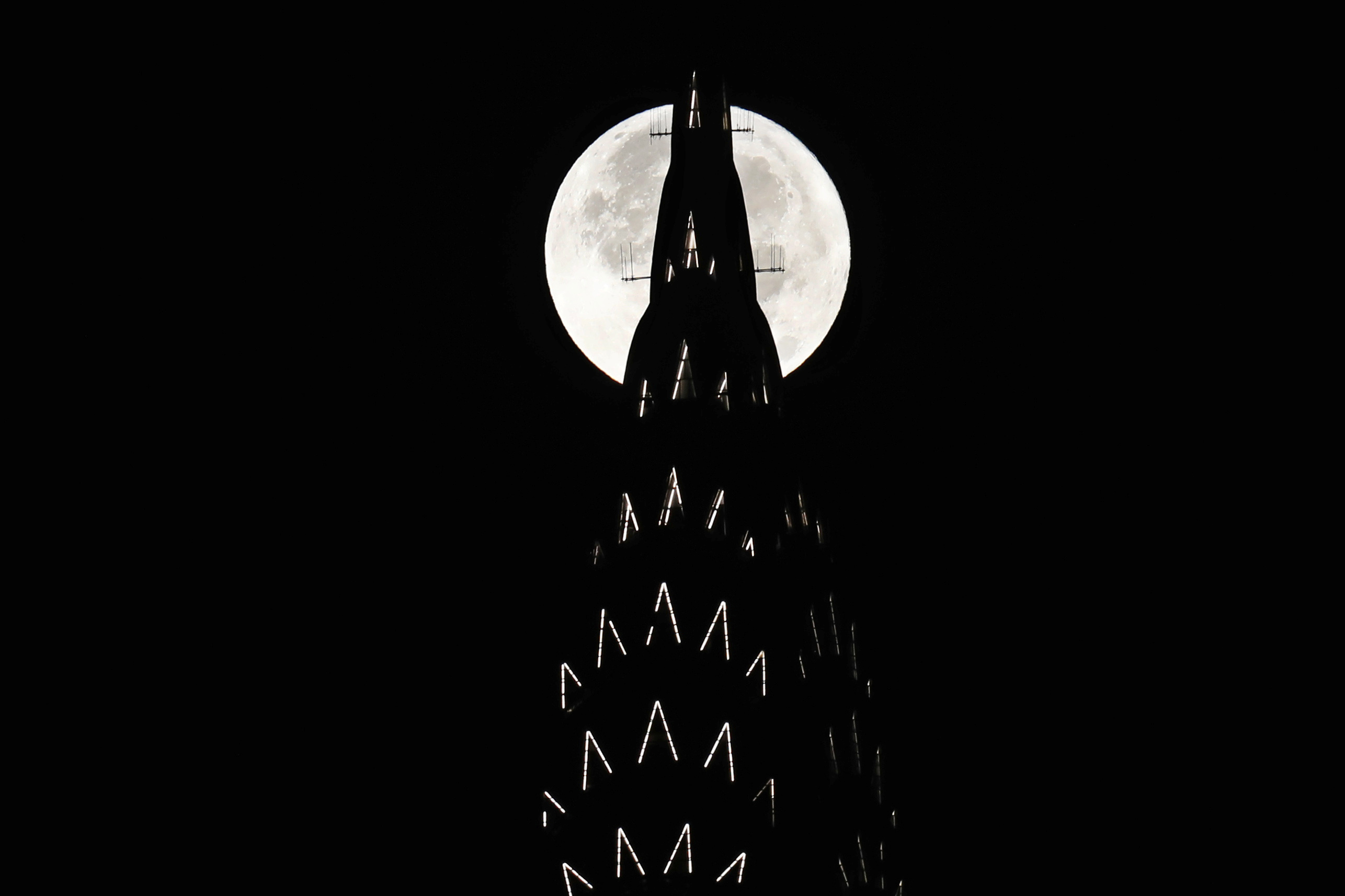The supermoon sets behind the Chrysler Building in New York. Photo by Lucas Jackson/Reuters
