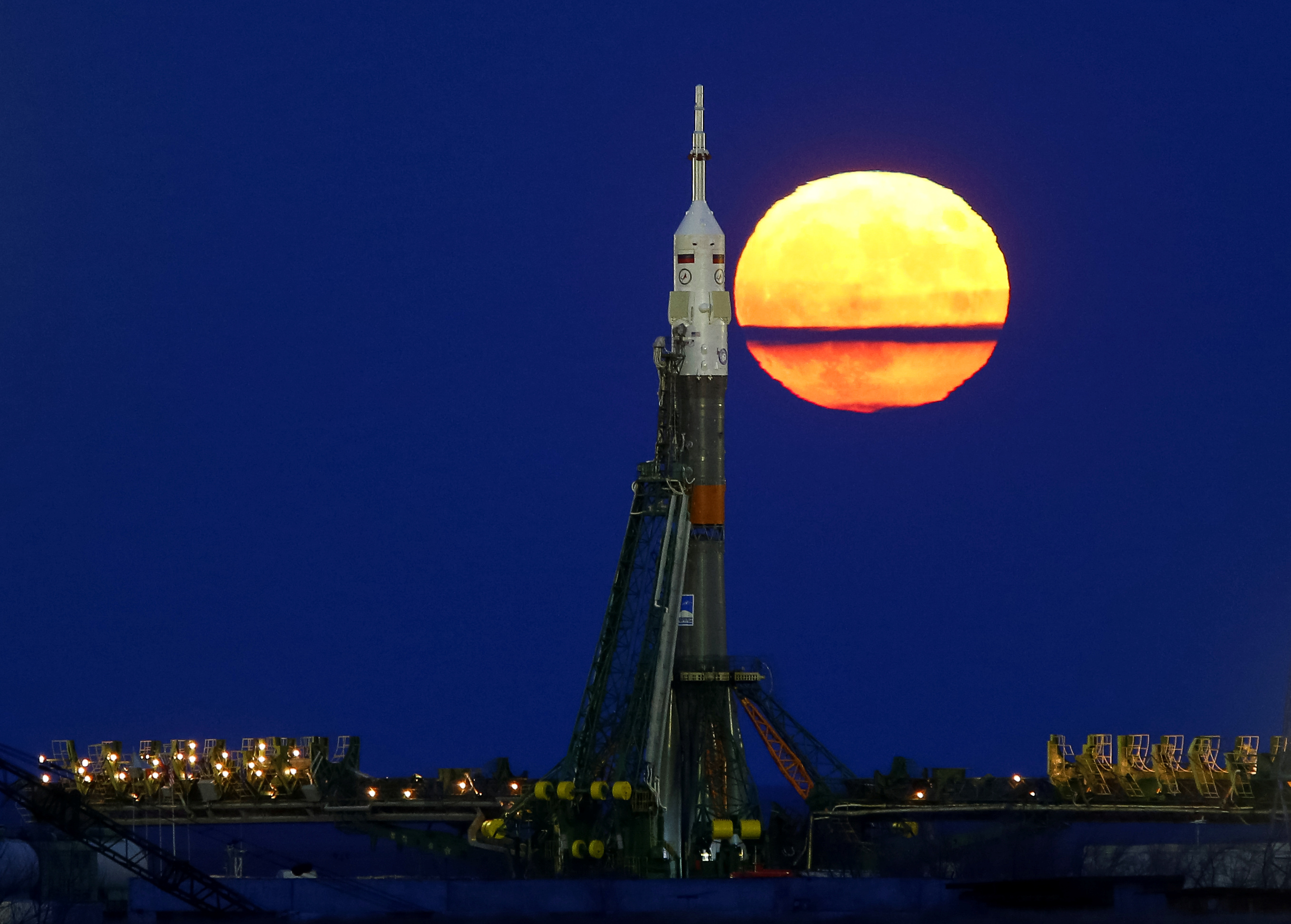 The supermoon rises behind the Soyuz MS-03 spacecraft, ahead of its upcoming launch to the International Space Station, at the Baikonur cosmodrome in Kazakhstan. Photo by Shamil Zhumatov/Reuters