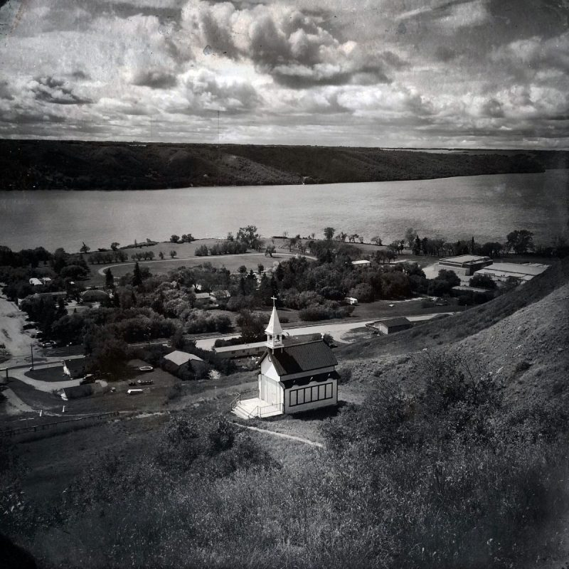 This picturesque little village is Lebret, Saskatchewan -- home to the Qu'Appelle Indian Residential School, which operated under the federal government and Catholic Church from 1884-1969, and under the governance of the Star Blanket Cree Nation from 1973-1998. While most of the original school structures have been demolished, one building remains, visible on the far right side of the photo. Photo by Daniella Zalcman