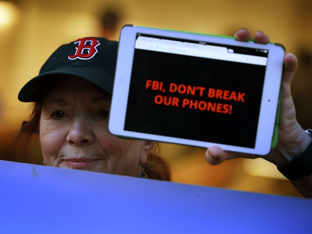 Protesters demonstrate outside an Apple Store as they object to the US Government's attempt to put a backdoor to hack into the Apple iPhone, in Los Angeles, California on February 23, 2016. Photo  Mark Ralston/AFP/Getty Images