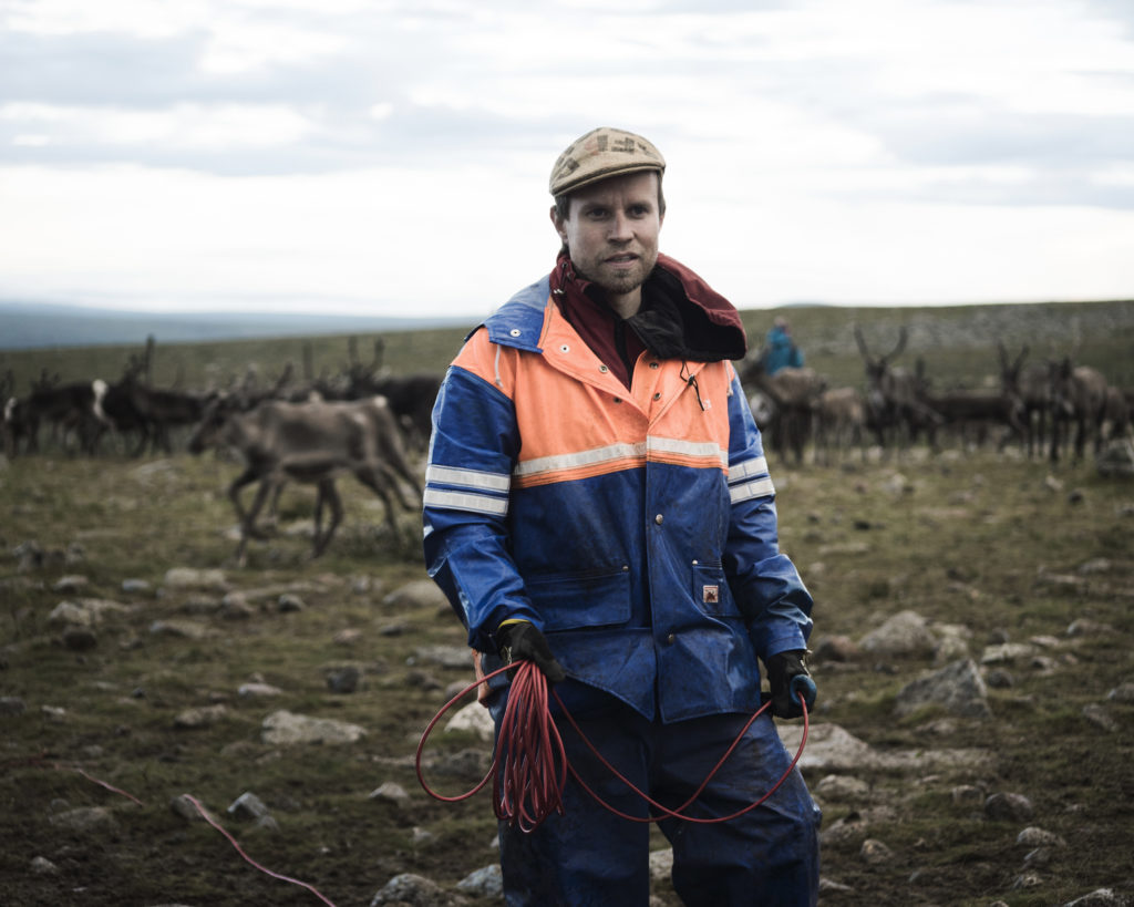 Simon Issát Marainen herds reindeer with his family outside of Nedre Soppero, Sweden. Photo by Camilla Andersen