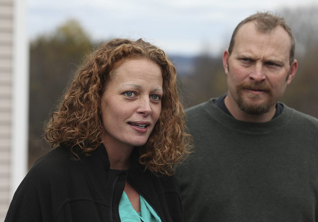 Nurse Kaci Hickox (L) joined by her boyfriend Ted Wilbur spoke with the media outside of their home in Fort Kent, Maine October 31, 2014. Maine Governor Paul LePage wanted Hickox to be quarantined in her house even though she had tested negative for the virus and said she was healthy at the time. Photo by Joel Page/REUTERS