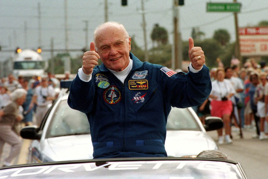 Astronaut John Glenn gives a thumbs up to onlookers at a parade in Cocoa Beach to honor the astronauts of STS 95/ This was the first parade held to honor astronauts in Cocoa Beach in almost a decade. The seven astronauts rode atop white Chevrolet Corvettes as a few thousand spectators cheered them on. Photo by Reuters.