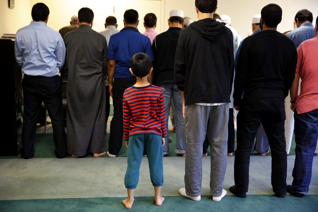 A boy attends the afternoon prayer at the mosque of All Dulles Area Muslim Society (ADAMS) in Sterling, Virginia, U.S. May 19, 2016. To match Special Report USA-EXTREMISTS/TEEN REUTERS/Carlos Barria - RTSG93W