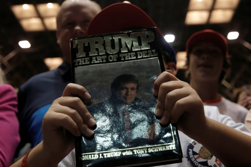 A boy holds a book by Republican presidential nominee Donald Trump at a campaign rally in Canton, Ohio, in September. Photo by Mike Segar/Reuters