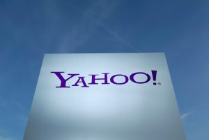 A Yahoo logo is pictured in front of a building in Rolle, east of Geneva, Switzerland. Photo by Denis Balibouse/Reuters