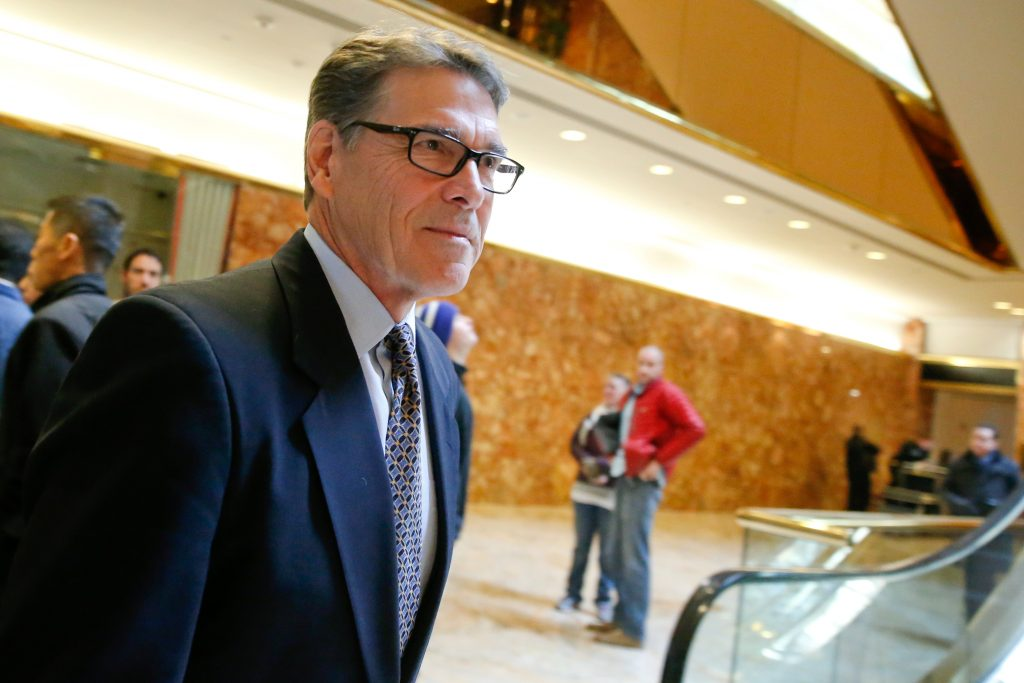 Former Texas Gov. Rick Perry exits after meeting with President-elect Donald Trump at Trump Tower in New York. Photo by Br...