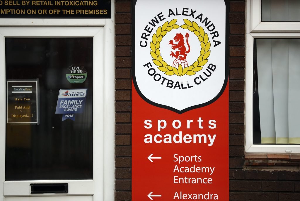 Signs are seen at the Crewe Alexandra Football Club ground in Crewe, Britain. Photo by Phil Noble/Reuters