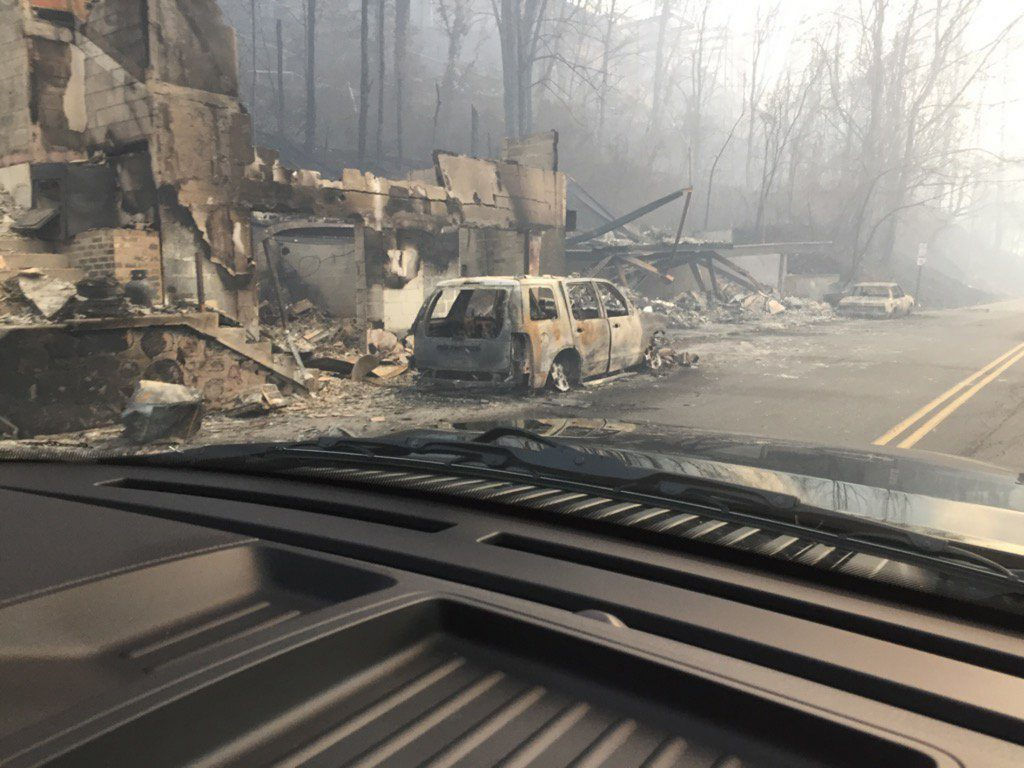Burned buildings and cars aftermath of wildfire is seen in this image released in social media by Tennessee Highway Patrol in Gatlinburg, Tennessee. Picture taken on November 29, 2016. Photo courtesy of Tennessee Highway Patrol/Handout via Reuters