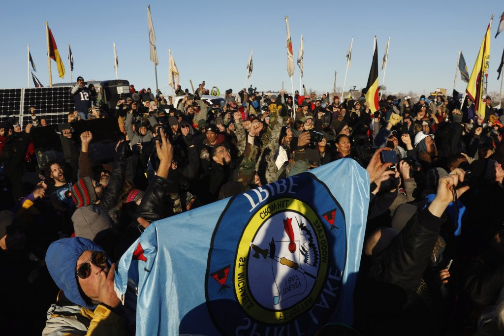 "Native American and visiting ""water protectors"" celebrate  that the Army Corps of Engineers has denied an easement for the $3.8 billion Dakota Access Pipeline inside of the Oceti Sakowin camp as demonstrations continue against plans to pass the Dakota Access pipeline near the Standing Rock Indian Reservation, near Cannon Ball, North Dakota, U.S., December 4, 2016.  REUTERS/Lucas Jackson - RTSUMQG"