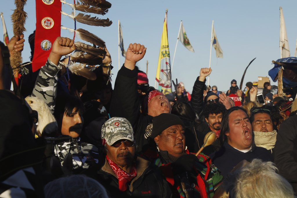 "Native American ""water protectors"" and their allies celebrate that the Army Corps of Engineers has denied an easement for the $3.8 billion Dakota Access Pipeline near Cannon Ball, North Dakota, on Dec. 4, 2016. Photo by Lucas Jackson/Reuters"