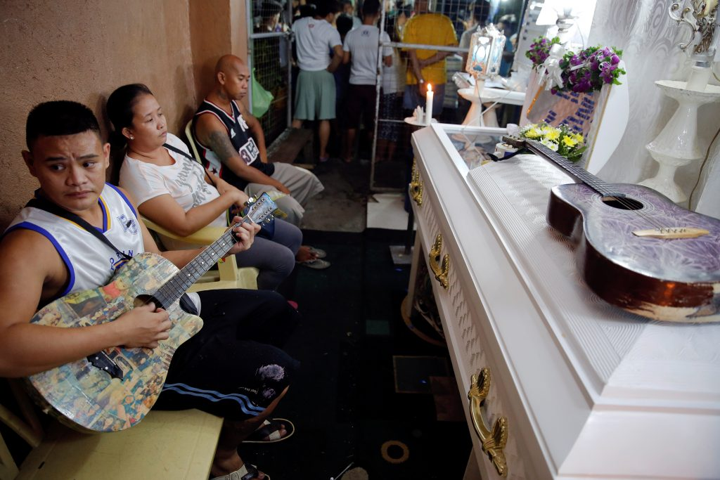 Friends and relatives of Florjohn Cruz, who was killed in a police drugs buy-bust operation, gather around his coffin during his wake in Manila, Philippines. Photo by REUTERS/Damir Sagolj