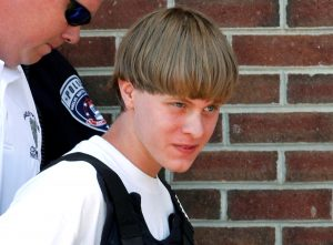 Police lead Dylann Roof into the courthouse in Shelby, North Carolina, on in June 2015. Photo by Jason Miczek/Reuters