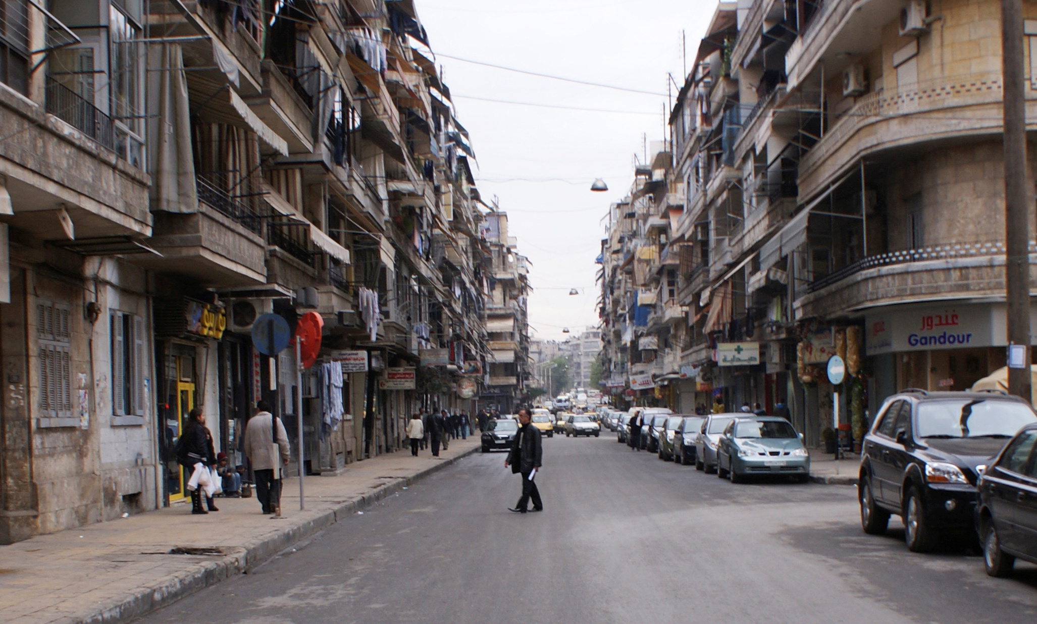 A man crosses a street in Aleppo on Dec. 12, 2009. Photo by Khalil Ashawi/Reuters