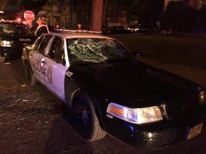 A police car with broken windows is seen in a photograph released by the Milwaukee Police Department after disturbances following the August police shooting of a man in Milwaukee, Photo by Milwaukee Police via Reuters