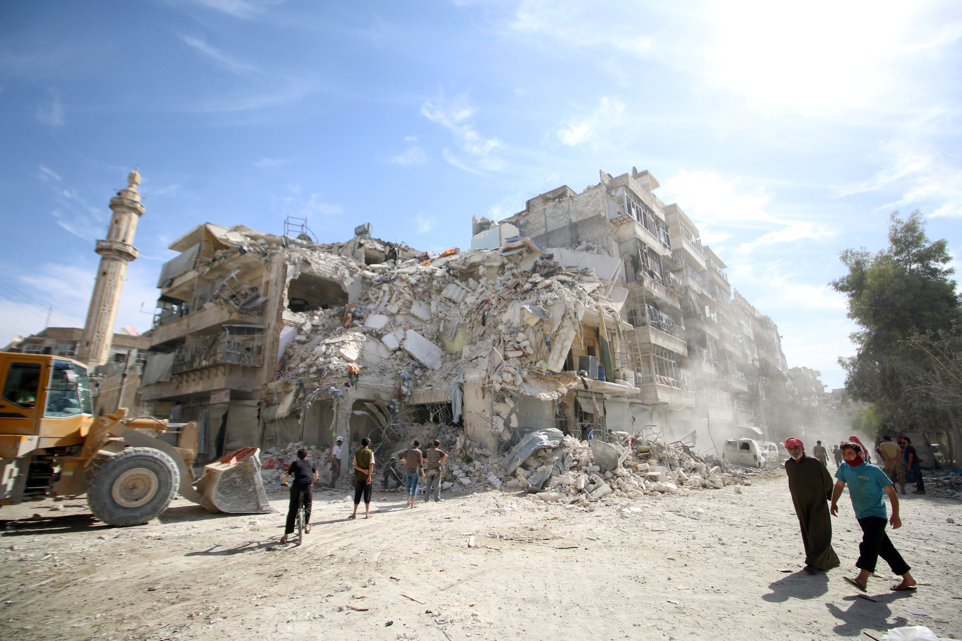 People inspect a site destroyed by an air strike in the rebel-held al-Qaterji neighborhood of Aleppo on Oct. 17. Photo by Abdalrhman Ismail/Reuters