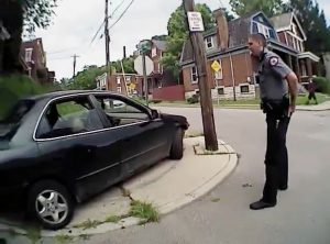 University of Cincinnati police officer Ray Tensing stands near a car after driver Samuel Dubose was allegedly pulled over and shot during a traffic stop in Cincinnati, Ohio July 19, 2015, in a still image from body camera video released by the Hamilton County Prosecutor's Office on July 29, 2015. Photo courtesy of Hamilton County Prosecutor's Office/Handout via Reuters
