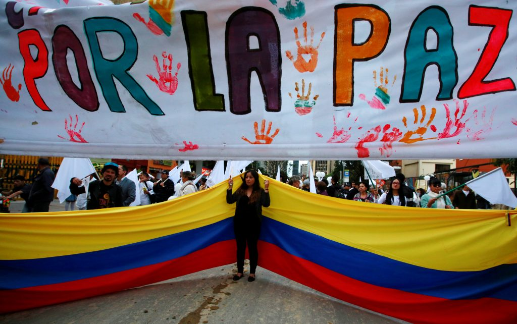 Peace on Earth—that's worth celebrating. Supporters rallied before the agreement, in Colombia. Photo by John Vizcaino/Reuters.