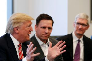 U.S. President-elect Donald Trump speaks as PayPal co-founder and Facebook board member Peter Thiel (center) and Apple Inc CEO Tim Cook look on during a meeting with technology leaders at Trump Tower in New York U.S., December 14, 2016. Photo by Shannon Stapleton/REUTERS