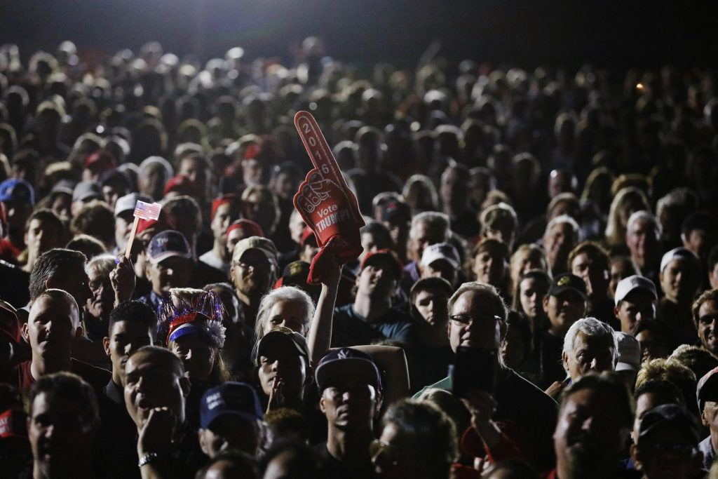People watch as U.S. President-elect Donald Trump speaks during a USA Thank You Tour event in Orlando, Florida, U.S., December 16, 2016. REUTERS/Lucas Jackson - RTX2VEP4