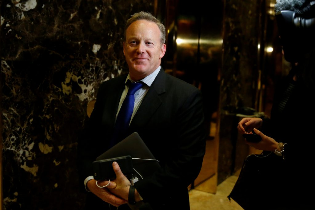 hief Strategist & Communications Director for the Republican National Committee Sean Spicer arrives in the lobby of Republican president-elect Donald Trump's Trump Tower in New York, New York, U.S. November 14, 2016. REUTERS/Carlo Allegri/File Photo