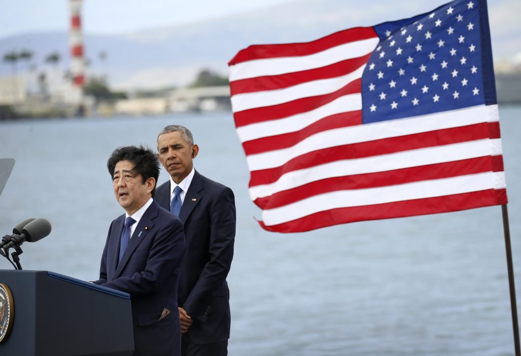 Japanese Prime Minister Shinzo Abe (L) delivers remarks as U.S. President Barack Obama looks on at Joint Base Pearl Harbor-Hickam, Hawaii. Photo by Kevin Lamarque/Reuters