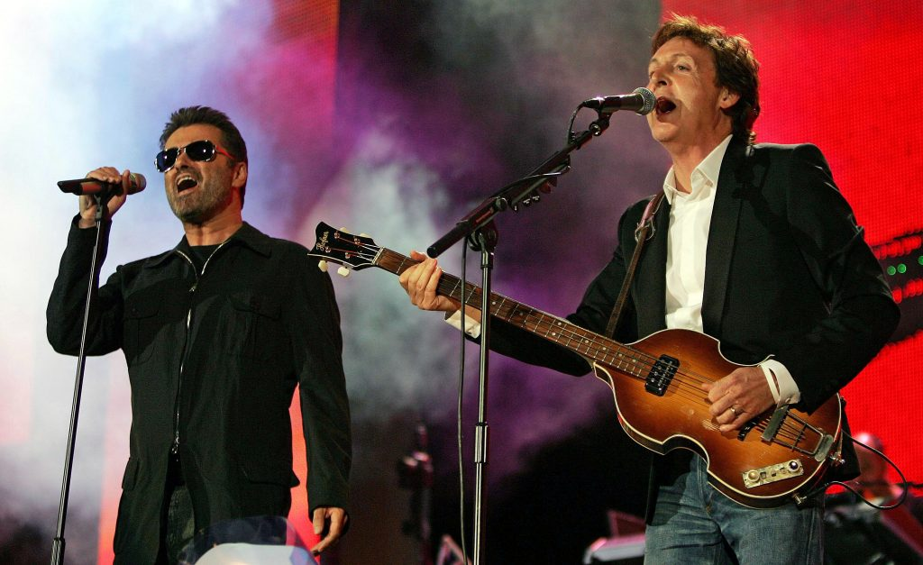 British singers Paul McCartney and George Michael (L) perform at the Live 8 concert in Hyde Park in London, July 2, 2005. A galaxy of rock and roll stars will grace stages across the globe on Saturday for what is being billed as the greatest music show ever, in a bid to put pressure on leaders of the Group of Eight major industrialised nations meeting in Scotland next week to do more to alleviate poverty, particularly in Africa. Live8, an expanded version of the Live Aid sensation 20 years ago, will take in 10 cities and four continents, kicking off in [Tokyo in the east and ending in North America] in the west. - RTXNLLT