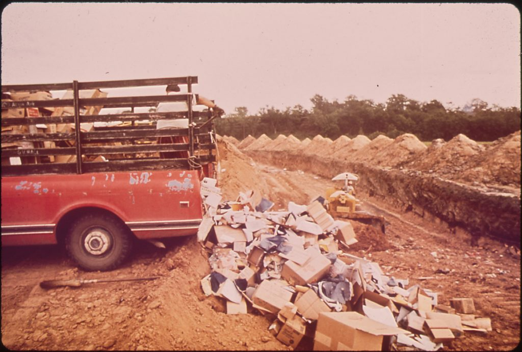 Solid waste is dumped into trenches at this sanitary landfill in Fort Smith, Arkansas (April 1972). Picture was taken as part of the EPA's DOCUMERICA Project. Photo by Jim Olive