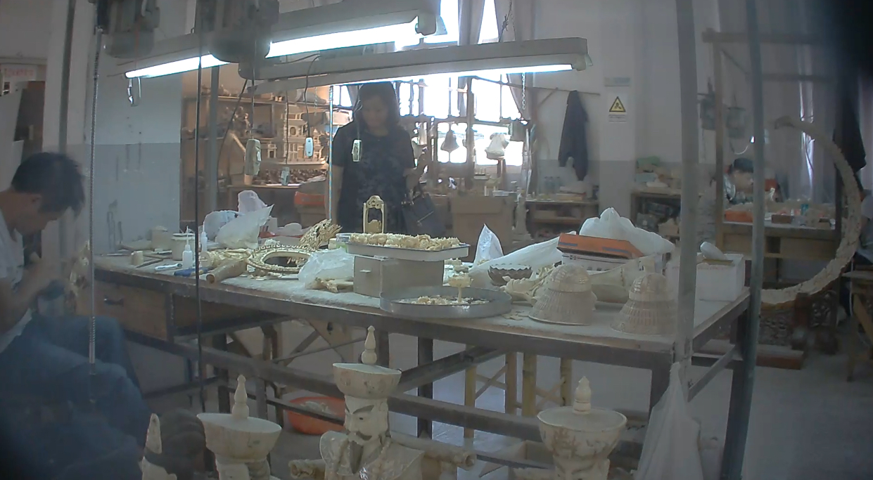 An artisan carves ivory in a workshop in Putian, China. Photo courtesy of Elephant Action League