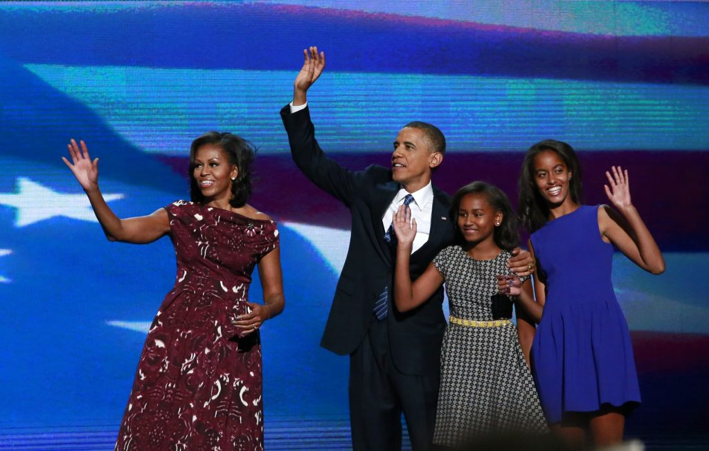U.S. President Barack Obama is joined onstage by first lady Michelle Obama and his daughters Sasha (2nd R) and Malia (R) after accepting the 2012 U.S Democratic presidential nomination during the final session of the Democratic National Convention in Charlotte, North Carolina, September 6, 2012. REUTERS/Adrees Latif (UNITED STATES - Tags: ELECTIONS POLITICS) - RTR37M0J