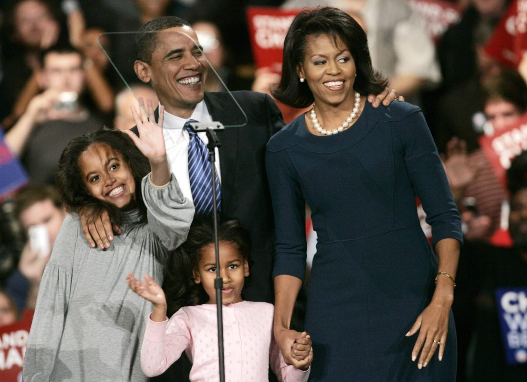Democratic presidential candidate U.S. Senator Barack Obama (D-IL) is cheered by supporters after he won the Democratic Iowa caucuses in Des Moines, Iowa January 3, 2008. Obama's wife Michelle (R) and daughters Malia (L) and Sasha are seen with him. REUTERS/Keith Bedford (UNITED STATES) - RTX57AQ