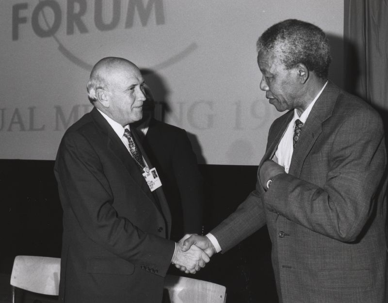 South African President F. W. de Klerk meets with. Nelson Mandela and Chief Mangosuthu Buthelezi at the. World Economic Forum in 1992. Photo courtesy of World Economic Forum