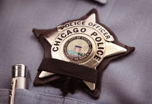 A black band is stretched across a District 1 Chicago Police officer's badge to mourn the death of a fellow officer on July 19, 2010 in Chicago, Illinois. District 1 officer Michael Bailey was killed in front of his home after getting off duty Sunday morning in what appeared to be an attempted carjacking. Bailey was the third Chicago police officer shot and killed since mid-May. (Photo by Scott Olson/Getty Images)