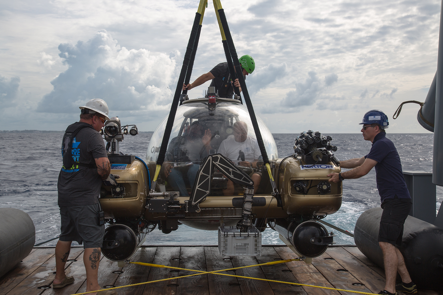 Nekton Mission crew launches the Nomad submersible with pilot Kelvin Magee and NewsHour science producer Nsikan Akpan