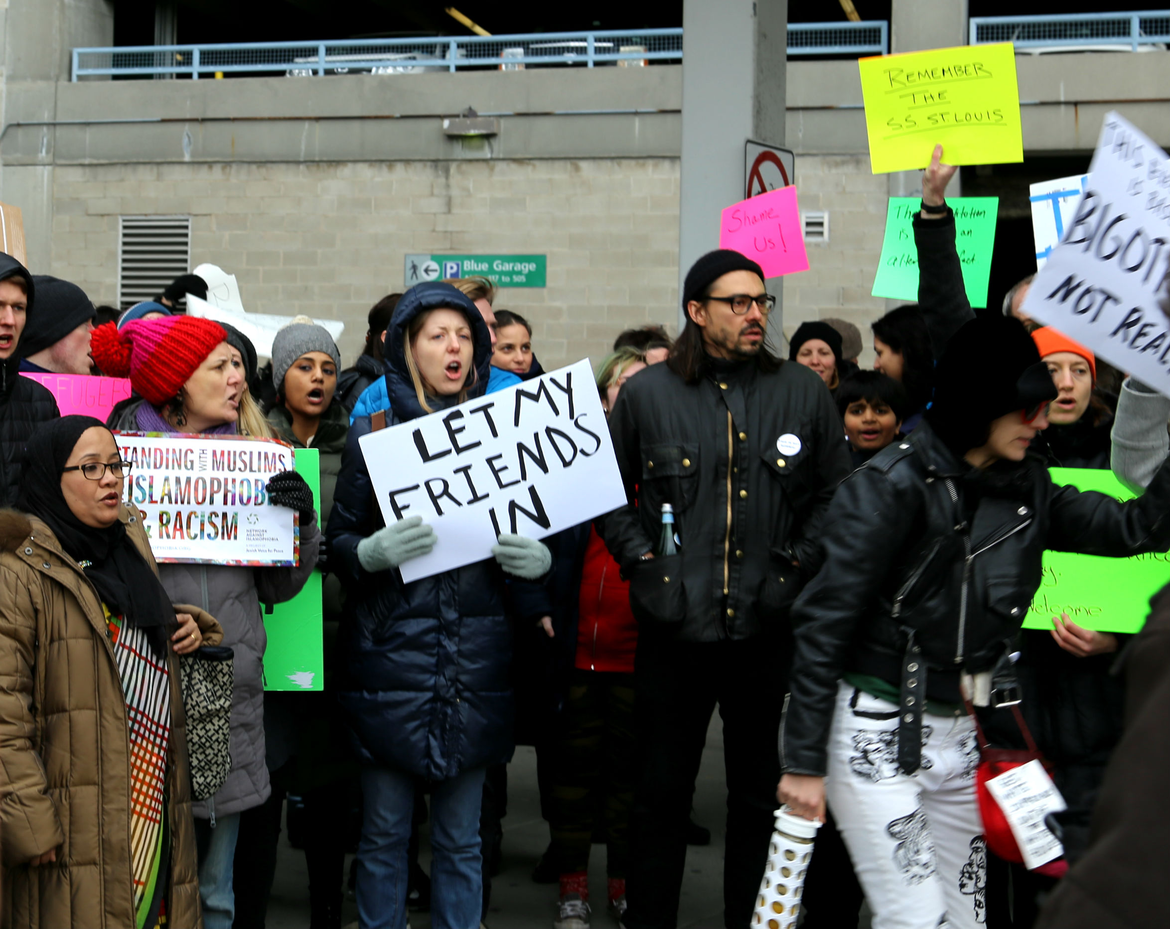 The protest began to grow after an immigrant advocacy group put a call-out for demonstrators on social media. Photo By Micheal D. Regan/PBS NewsHour
