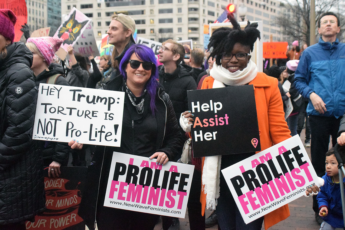 Anti-abortion advocates Destiny Herndon De-La Rosa, the founder of New Wave Feminists, and Cessilye Smith (right) proudly represented a minority opinion at the Women's March on Washington. Their group emphasizes that being pro-life and feminist are not mutually exclusive.