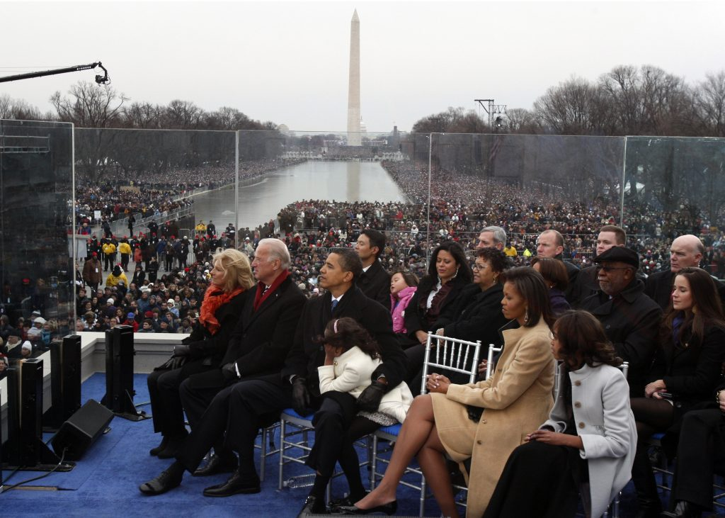 U.S. President-elect Barack Obama (C) puts his arm around his daughter Sasha as they sit onstage with his wife Michelle (2nd R), Malia Obama (far R), Vice President-elect Joe Biden (2nd L) and his wife Jill during the 'We Are One': Inaugural Celebration at the Lincoln Memorial in Washington January 18, 2009. REUTERS/Jim Young (UNITED STATES) - RTR23K7H