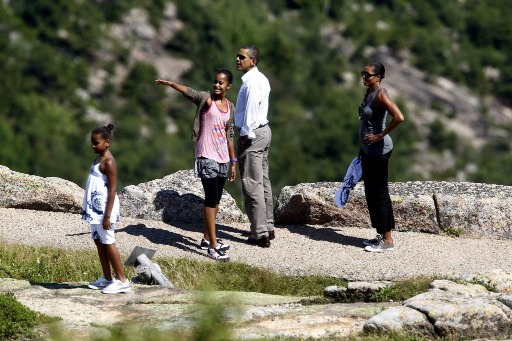 U.S. President Barack Obama (2nd R) and his wife Michelle (R) walk along a trail with their daughters Sasha (L) and Malia on Cadillac Mountain in Bar Harbor, Maine, July 16, 2010. The First Family is on vacation for the weekend. REUTERS/Jim Young (UNITED STATES - Tags: POLITICS TRAVEL) - RTR2GH4V