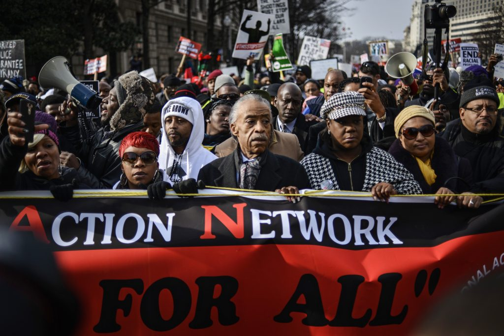 Al Sharpton (C) leads a march with family members of Eric Garner, Michael Brown, Tamir Rice and Trayvon Martin to Capitol Hill in a protest against police violence organized by the National Action Network in Washington December 13, 2014. Photo by Lawler Duggan/Reuters