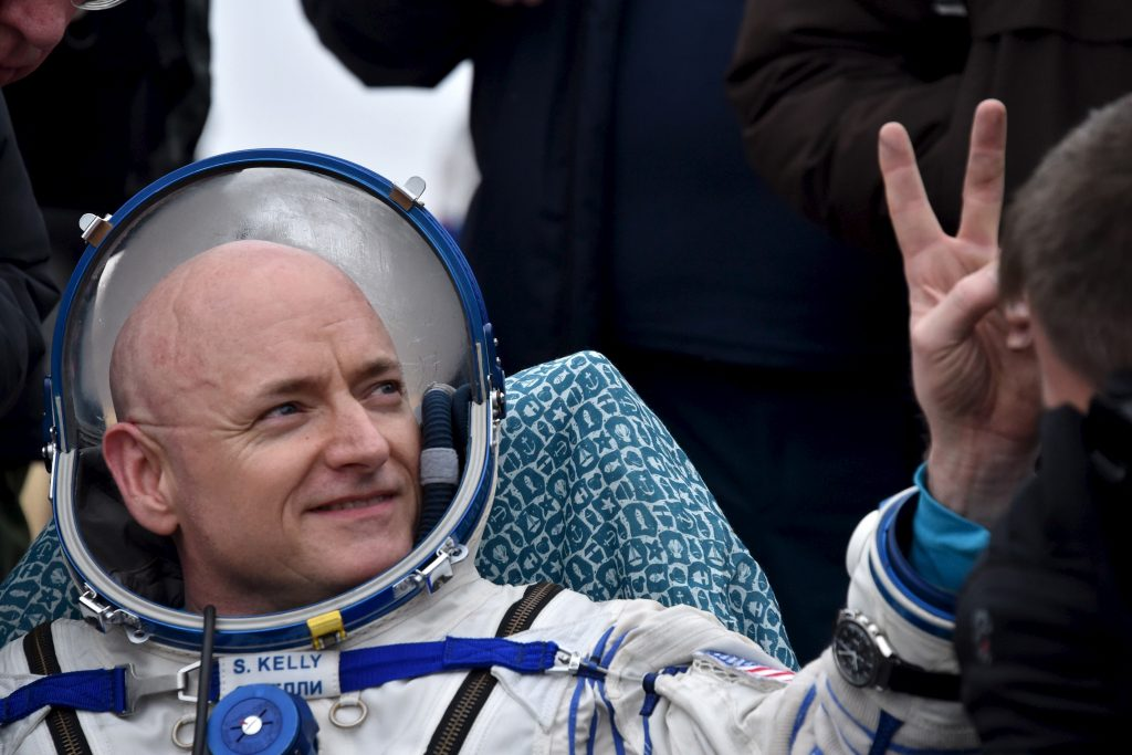 U.S. astronaut Scott Kelly gestures shortly after landing in Kazakhstan, March 2, 2016. REUTERS/Kirill Kudryavtsev/