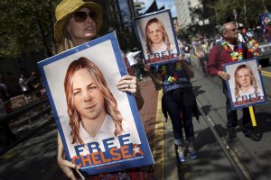 People hold signs calling for the release of imprisoned WikiLeaks whistleblower Chelsea Manning while marching in a 2015 gay pride parade in San Francisco, California. Photo by Elijah Nouvelage/Reuters