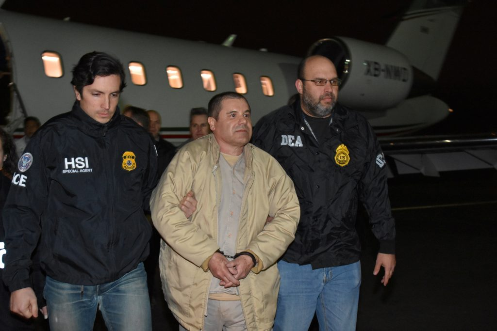 "Mexico's top drug lord Joaquin ""El Chapo"" Guzman is escorted as he arrives at Long Island MacArthur airport in New York, U.S., January 19, 2017, after his extradition from Mexico. Photo courtesy: U.S. officials/Handout via Reuters"