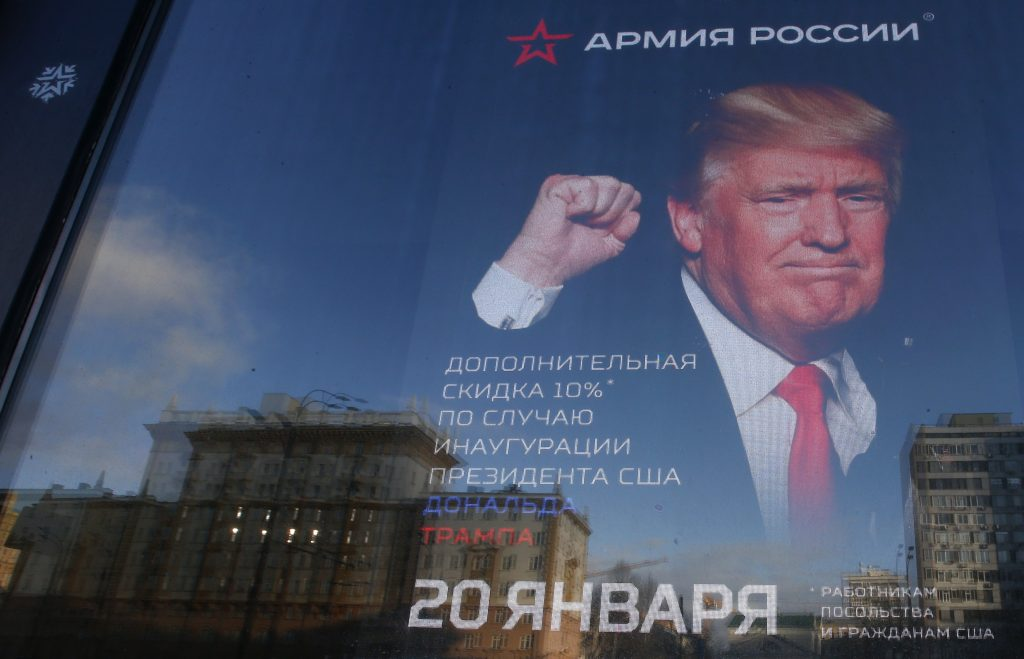 """A pedestrian walks past the store """"Army of Russia"""", located opposite the U.S. embassy, with an image of U.S. President-ele..."""