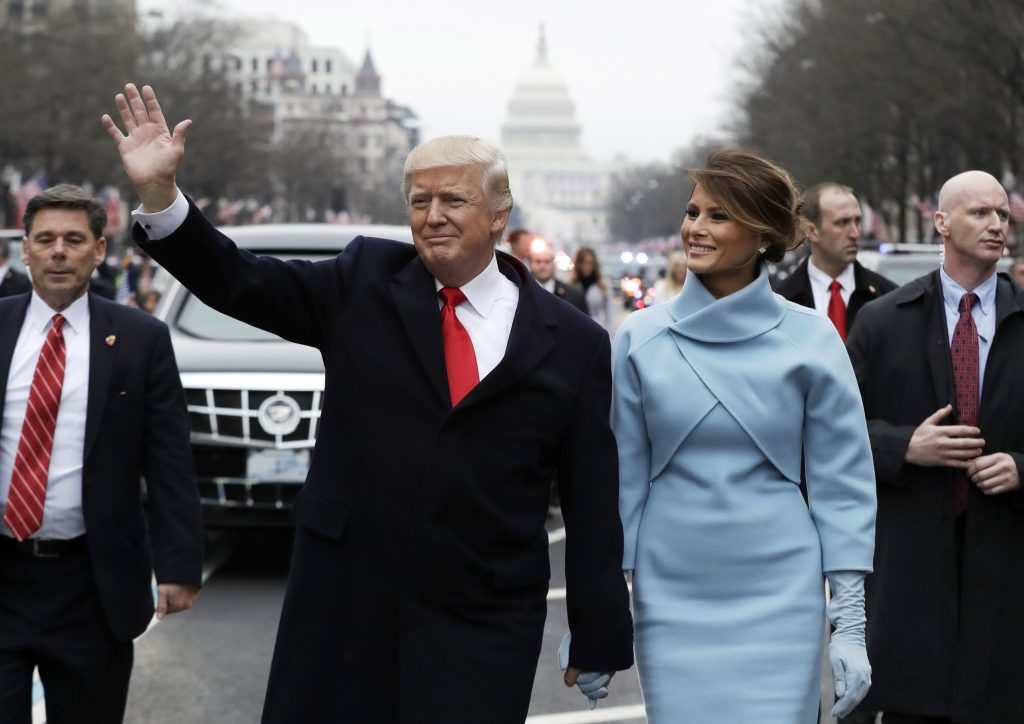 President Donald Trump walks with first lady Melania Trump down Pennsylvania Avenue after his swearing in ceremony in Washington, D.C., on Jan. 20. Photo by Evan Vucci/Pool via Reuters
